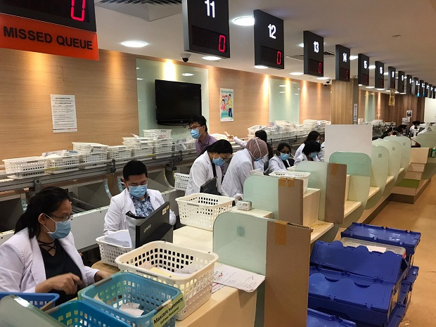Block 3 Pharmacy was converted to a logistics centre for SGH's Medication Delivery Service, which experienced increased demand due to COVID-19. Patients with non-urgent medical needs are urged to avoid visiting the hospital.