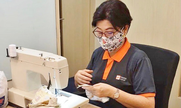Tan Siam King siewing masks for charity. PHOTOS SINGHEALTH POLYCLINICS