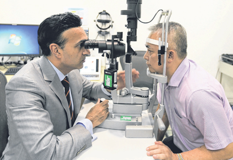 Businessmen suffering from eye disease 30 years laser surgery to remove pterygium